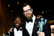 Actors Sam Richardson (L) and Timothy Simons, co-winners of the Outstanding Performance by an Ensemble in a Comedy Series award for 'Veep,' attend the 24th Annual Screen Actors Guild Awards at The Shrine Auditorium on January 21, 2018 in Los Angeles, California. 27522_011