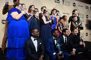 (Standing row L-R) Actors Jermel Nakia, Chrissy Metz, Alexandra Breckenridge, Mandy Moore, Parker Bates, Hannah Zeile, Logan Shroyer, Lonnie Chavis, Chris Sullivan, Susan Kelechi Watson, Eris Baker, Milo Ventimiglia, and Faithe Herman, (Seated row L-R) Actors Sterling K. Brown, Niles Fitch, Jon Huertas, and Justin Hartley, winners of Outstanding Performance by an Ensemble in a Drama Series for 'This Is Us,' pose in the press room during the 24th Annual Screen Actors Guild Awards at The Shrine Auditorium on January 21, 2018 in Los Angeles, California.