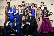 (Standing row L-R) Actors Jermel Nakia, Chrissy Metz, Alexandra Breckenridge, Mandy Moore, Hannah Zeile, Logan Shroyer, Lonnie Chavis, Chris Sullivan, Susan Kelechi Watson, Eris Baker, Milo Ventimiglia, and Faithe Herman, (Seated row L-R) Actors Sterling K. Brown, Niles Fitch, Justin Hartley, and Jon Huertas, winners of Outstanding Performance by an Ensemble in a Drama Series for 'This Is Us,' pose in the press room during the 24th Annual Screen Actors Guild Awards at The Shrine Auditorium on January 21, 2018 in Los Angeles, California.