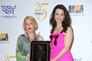 (L-R)  Actress Tippi Hedren with Kristin Davis who was awarded with the Wyler Award pose in the press room at the 25th Anniversary Genesis Awards held at the Hyatt Regency Century Plaza Hotel on March 19, 2011 in Los Angeles, California.