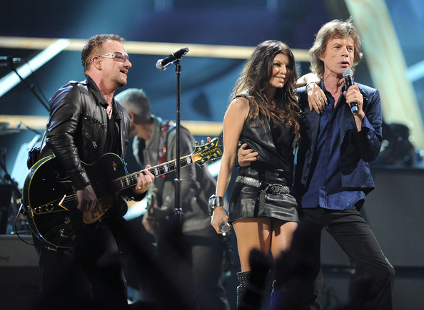 Bono of U2, Fergie of Black Eyed Peas and Mick Jagger of The Rolling Stones perform with U2 onstage at the 25th Anniversary Rock & Roll Hall of Fame Concert at Madison Square Garden on October 30, 2009 in New York City.