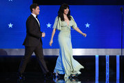 (L-R) Adam DeVine and Edi Patterson walk onstage during the 25th Annual Critics' Choice Awards at Barker Hangar on January 12, 2020 in Santa Monica, California.