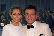 Dancer Kym Johnson (L) and businessman Robert Herjavec attend the 25th Annual Elton John AIDS Foundation's Academy Awards Viewing Party at The City of West Hollywood Park on February 26, 2017 in West Hollywood, California.