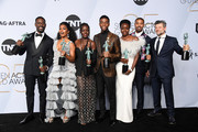 (L-R) Sterling K. Brown, winner of Outstanding Performance by a Cast in a Motion Picture for 'Black Panther' and Outstanding Performance by an Ensemble in a Drama Series for 'This Is Us;' Angela Bassett, Lupita Nyong'o, Chadwick Boseman, Danai Gurira, Michael B. Jordan, and Andy Serkis, winners of Outstanding Performance by a Cast in a Motion Picture for 'Black Panther,' pose in the press room during the 25th Annual Screen ActorsGuild Awards at The Shrine Auditorium on January 27, 2019 in Los Angeles, California.