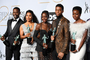 (L-R) Sterling K. Brown, winner of Outstanding Performance by a Cast in a Motion Picture for 'Black Panther' and Outstanding Performance by an Ensemble in a Drama Series for 'This Is Us;' Angela Bassett, Lupita Nyong'o, Chadwick Boseman, and Danai Gurira, winners of Outstanding Performance by a Cast in a Motion Picture for 'Black Panther,' pose in the press room during the 25th Annual Screen ActorsGuild Awards at The Shrine Auditorium on January 27, 2019 in Los Angeles, California.