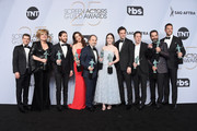 (L-R) Joel Johnstone, Caroline Aaron, Michael Zegen, Marin Hinkle, Kevin Pollak, Rachel Brosnahan, Luke Kirby, Brian Tarantina, Tony Shalhoub, and Zachary Levi pose in the press room with awards for Outstanding Performance by an Ensemble in a Comedy Series in The Marvelous Mrs. Maisel during the 25th Annual Screen Actors Guild Awards at The Shrine Auditorium on January 27, 2019 in Los Angeles, California. 480645