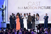 """(L-R) Sterling K. Brown, Sydelle Noel, Michael B. Jordan, Danai Gurira, Isaach De Bankole, Chadwick Boseman, Lupita Nyong'o, Angela Bassett, and Andy Serkis accept the Outstanding Performance by a Cast in a Motion Picture for """"Black Panther"""" onstage during the 25th Annual Screen ActorsGuild Awards at The Shrine Auditorium on January 27, 2019 in Los Angeles, California."""