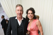 Tim Allen (L) and Jane Hajduk attend the 26th annual Elton John AIDS Foundation Academy Awards Viewing Party with cocktails by Clase Azul Tequila at The City of West Hollywood Park on March 4, 2018 in West Hollywood, California.