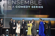 (L-R) Tony Shalhoub, Kevin Pollak, Alex Borstein, Stephanie Hsu, Michael Zegen, Marin Hinkle, Rachel Brosnahan, Caroline Aaron, Joel Johnstone, Matilda Szydagis, and Jane Lynch accept Outstanding Performance by an Ensemble in a Comedy Series for 'The Marvelous Mrs. Maisel' onstage at the 26th Annual Screen Actors Guild Awards at The Shrine Auditorium on January 19, 2020 in Los Angeles, California. 721359