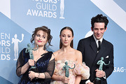 """The Crown"" cast Helena Bonham Carter (L), Josh O'Connor and Erin Doherty pose in the press room with the trophy for Outstanding Performance by an Ensemble in a Drama Series during the 26th Annual Screen Actors Guild Awards at The Shrine Auditorium on January 19, 2020 in Los Angeles, California. 721430"