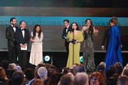 (L-R) Tony Shalhoub, Kevin Pollak, Alex Borstein, Stephanie Hsu, Michael Zegen, Marin Hinkle, Rachel Brosnahan, Caroline Aaron, Joel Johnstone, Matilda Szydagis, and Jane Lynch accept Outstanding Performance by an Ensemble in a Comedy Series for 'The Marvelous Mrs. Maisel' with Sterling K. Brown onstage during the 26th Annual Screen Actors Guild Awards at The Shrine Auditorium on January 19, 2020 in Los Angeles, California.
