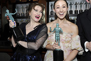 (L-R) Helena Bonham Carter and Erin Doherty, winners of Outstanding Performance by an Ensemble in a Drama Series pose in the trophy room during the 26th Annual Screen Actors Guild Awards at The Shrine Auditorium on January 19, 2020 in Los Angeles, California. 721453