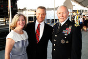 General Martin E. Dempsey (R), Chairman, Joint Chiefs of Staff, and his wife, Deanie Dempsey, pose for a photo with actor and co-host Gary Sinise (C) at the 26th National Memorial Day Concert on May 24, 2015 in Washington, DC.