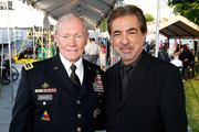 General Martin E. Dempsey, Chairman, Joint Chiefs of Staff, and actor and co-host Joe Mantegna pose for a photo at the 26th National Memorial Day Concert on May 24, 2015 in Washington, DC.
