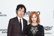 (L-R) Geoffrey Arend and Christina Hendricks attend the 27th annual Elton John AIDS Foundation Academy Awards Viewing Party sponsored by IMDb and Neuro Drinks celebrating EJAF and the 91st Academy Awards on February 24, 2019 in West Hollywood, California.
