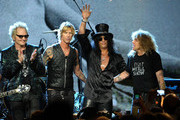 Inductees (L-R) Matt Sorum, Duff McKagan, Slash and Steven Adler of Guns N' Roses, perform onstage during the 27th Annual Rock And Roll Hall of Fame Induction Ceremony at Public Hall on April 14, 2012 in Cleveland, Ohio.