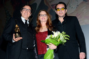 Director David O. Russell, actress Melissa Leo, and SBIFF director Roger Durling attend the presentation of the Outstanding Director Award at the Arlington Theatre at the 29th Santa Barbara International Film Festival on January 31, 2014 in Santa Barbara, California.