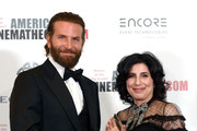 Actor Bradley Cooper (L) and honoree Sue Kroll pose with the Sid Grauman Award during the 30th Annual American Cinematheque Awards Gala at The Beverly Hilton Hotel on October 14, 2016 in Beverly Hills, California.