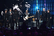 John Mayer, Doyle Bramhall II, Gary Clark Jr., Chris Layton Jimmie Vaughan, Tommy Shannon and Reese Wynans perform a song by inductee Stevie Ray Vaughan and Double Trouble onstage during the 30th Annual Rock And Roll Hall Of Fame Induction Ceremony at Public Hall on April 18, 2015 in Cleveland, Ohio.