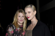 Charlize Theron and Laura Dern Photos Photo