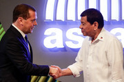 Russian Prime Minister Dmitry Medvedev (L) shakes hands with Philippine President Rodrigo Duterte (R) before the opening ceremony of the 31st Association of Southeast Asian Nations (ASEAN) Summit in Manila on November 13, 2017. .World leaders are in the Philippines' capital for two days of summits.  / AFP PHOTO / AFP PHOTO AND POOL / Mark R. CRISTINO