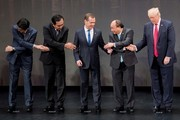 (L-R) Japan's Prime Minister Shinzo Abe, Thailand's Prime Minister Prayut Chan-O-Cha, Russian Prime Minister Dmitry Medvedev, Vietnam's Prime Minister Nguyen Xuan Phuc and US President Donald Trump join hands for a family photo during the opening ceremony of the 31st Association of South East Asian Nations (ASEAN) Summit in Manila on November 13, 2017..World leaders are in the Philippines' capital for two days of summits.  / AFP PHOTO / JIM WATSON