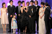 Actor Masaki Okada (2nd L), actress Mana Ashida (3rd L), actress Yoshino Kimura (centre L), director Tetsuya Nakashima (cetnre R) and actress Takako Matsu (2nd R) react on stage as their film 'Kokuhaku' (Confessions) receives the Best Picture award during the 34th Japan Academy Awards at Grand Prince Hotel New Takanawa on February 18, 2011 in Tokyo, Japan.