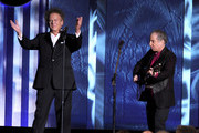 Musicians Art Garfunkel (L) and Paul Simon of Simon & Garfunkel perform onstage during the 38th AFI Life Achievement Award honoring Mike Nichols held at Sony Pictures Studios on June 10, 2010 in Culver City, California. The AFI Life Achievement Award tribute to Mike Nichols will premiere on TV Land on Saturday, June 25 at 9PM ET/PST.