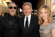 AFI Vice-Chairman Producer Jon Avnet, actor Harrison Ford, and actress Calista Flockhart arrive at the 38th AFI Life Achievement Award honoring Mike Nichols held at Sony Pictures Studios on June 10, 2010 in Culver City, California. The AFI Life Achievement Award tribute to Mike Nichols will premiere on TV Land on Saturday, June 25 at 9PM ET/PST.