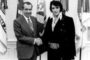 FILE PHOTO: President Richard Nixon meets with Elvis Presley December 21, 1970 at the White House.