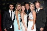(L-R) Actors Max Ehrich, Melissa Ordway; Hunter King, Matthew Atkinson, Kelli Goss, and Lachlan Buchanan pose in the press room during The 42nd Annual Daytime Emmy Awards at Warner Bros. Studios on April 26, 2015 in Burbank, California.