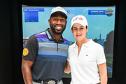 Long Drive Champion Maurice Allen (L) and LPGA Golfer Lorena Ochoa attend the 44 Million Yard Challenge at the Presidents Cup Fan Experience, Oculus World Trade Center on September 27, 2017 in New York City.