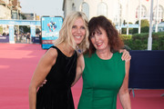 Sandrine Kiberlain and Sabine Azema pose on the red carpet before the opening ceremony of the 44th Deauville US Film Festival on August 31, 2018 in Deauville, France.