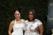 Tamera Mowry (L) and Loni Love attend the 45th annual Daytime Emmy Awards at Pasadena Civic Auditorium on April 29, 2018 in Pasadena, California.