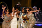 (L-R) Adrienne Bailon, Tamera Mowry, Loni Love and Jeannie Mai, winners of Outstanding Entertainment Talk Show Host for 'The Real', accept award onstage during the 45th annual Daytime Emmy Awards at Pasadena Civic Auditorium on April 29, 2018 in Pasadena, California.