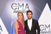 Recording artist Thomas Rhett (R) and Lauren Gregory attend the 49th annual CMA Awards at the Bridgestone Arena on November 4, 2015 in Nashville, Tennessee.