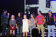 Singer Lee Brice (L) with guests Boston Gilbert, Ginger Gilbert Ravella, Bella Gilbert Ravella, Annalise Gilbert Ravella, Aspen Gilbert Ravella, and Greyson Ravella onstage at the 4th ACM Party for a Cause Festival at the Las Vegas Festival Grounds on April 2, 2016 in Las Vegas, Nevada.