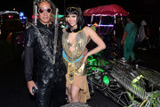 Henry Chang (L), driver of the MisterFusion Artcar, and model and parade queen Claire Sinclair attend the fourth annual Las Vegas Halloween Parade on October 31, 2013 in Las Vegas, Nevada.