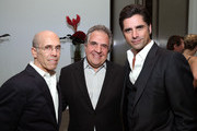 """(L-R) CEO of DreamWorks Animation Jeffrey Katzenberg, Chairman and Chief Executive Officer of Fox Filmed Entertainment Jim Gianopulos and actor John Stamos  attend the 4th Annual """"Reel Stories, Real Lives"""", benefiting the Motion Picture & Television Fund at Milk Studios on April 25, 2015 in Hollywood, California."""