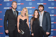 Charles Kelley of Lady Antebellum, Cassie McConnell, Kelli Cashiola, and Dave Haywood of Lady Antebellum attends the 52nd annual ASCAP Country Music awards at Music City Center on November 3, 2014 in Nashville, Tennessee.