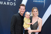 (FOR EDITORIAL USE ONLY) Tyler Hubbard of musical duo Florida Georgia Line, daughter and Hayley Hubbard attend the 52nd annual CMA Awards at the Bridgestone Arena on November 14, 2018 in Nashville, Tennessee.