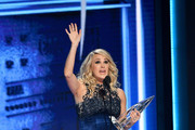 (FOR EDITORIAL USE ONLY) Carrie Underwood accepts an award onstage during the 52nd annual CMA Awards at the Bridgestone Arena on November 14, 2018 in Nashville, Tennessee.