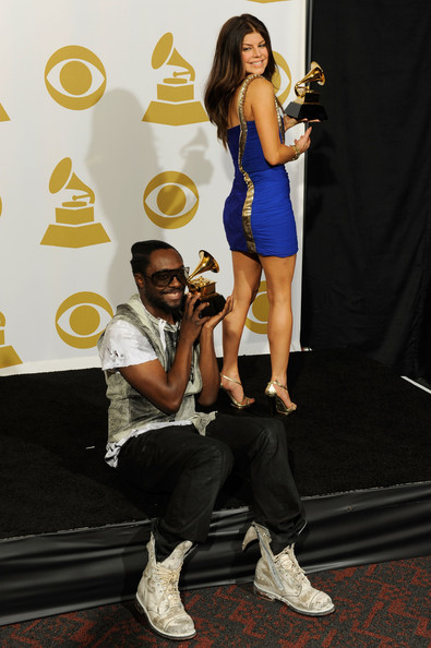 Musicians Will.i.am, and singer Fergie of Black Eyed Peas pose with Best Pop Performace award for 'I Got A Feeling', Best Pop Vocal Album award for 'The E.N.D.' and Best Short Form Music Video for 'Boom Boom Pow' in the press room during the 52nd Annual GRAMMY Awards held at Staples Center on January 31, 2010 in Los Angeles, California.