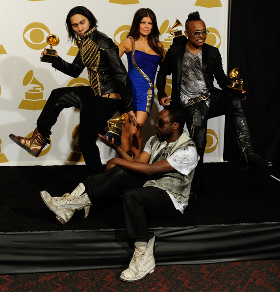 (L-R) Musicians Will.i.am (bottom),Taboo, Fergie and apl.de.ap of Black Eyed Peas poses with Best Pop Performace award for 'I Got A Feeling', Best Pop Vocal Album award for 'The E.N.D.' and Best Short Form Music Video for 'Boom Boom Pow' in the press room during the 52nd Annual GRAMMY Awards held at Staples Center on January 31, 2010 in Los Angeles, California.