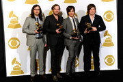 (L-R) Musicians Nathan Followill, Caleb Followill, Jared Followill and Matthew Followill of Kings Of Leon pose with Best Rock Performance By A Duo Or Group award, Record Of The Year award and Best Song award for 'Use Somebody' in the press room during the 52nd Annual GRAMMY Awards held at Staples Center on January 31, 2010 in Los Angeles, California.