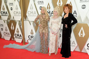 (FOR EDITORIAL USE ONLY) Carrie Underwood, Dolly Parton and Reba McEntire attend the 53rd annual CMA Awards at the Music City Center on November 13, 2019 in Nashville, Tennessee.