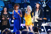 (FOR EDITORIAL USE ONLY)  Crystal Gayle, Reba McEntire and Carrie Underwood perform onstage during the 53rd annual CMA Awards at the Bridgestone Arena on November 13, 2019 in Nashville, Tennessee.