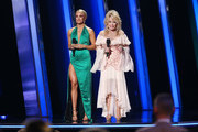 (FOR EDITORIAL USE ONLY) Carrie Underwood (L) and Dolly Parton speak onstage during the 53rd annual CMA Awards at the Bridgestone Arena on November 13, 2019 in Nashville, Tennessee.