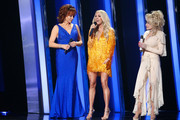 (FOR EDITORIAL USE ONLY) (L-R) Reba McEntire, Carrie Underwood and Dolly Parton perform onstage during the 53rd annual CMA Awards at the Music City Center on November 13, 2019 in Nashville, Tennessee.