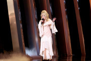 (FOR EDITORIAL USE ONLY) Dolly Parton speaks onstage during the 53rd annual CMA Awards at the Bridgestone Arena on November 13, 2019 in Nashville, Tennessee.